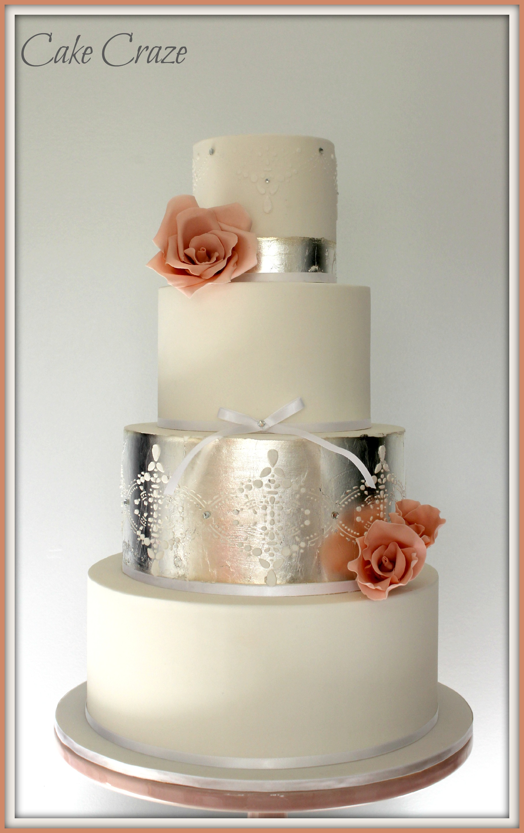 4 Tier Wedding Cake with stenciling and silver leaf