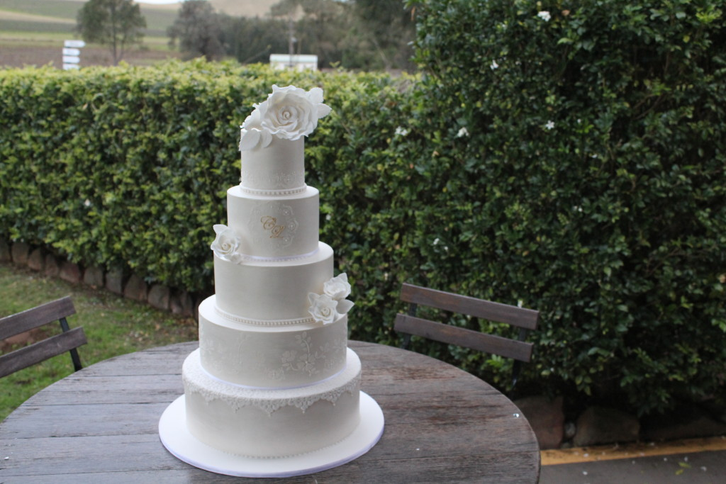 5 tier Lustred wedding cake with stenciling and sugar roses