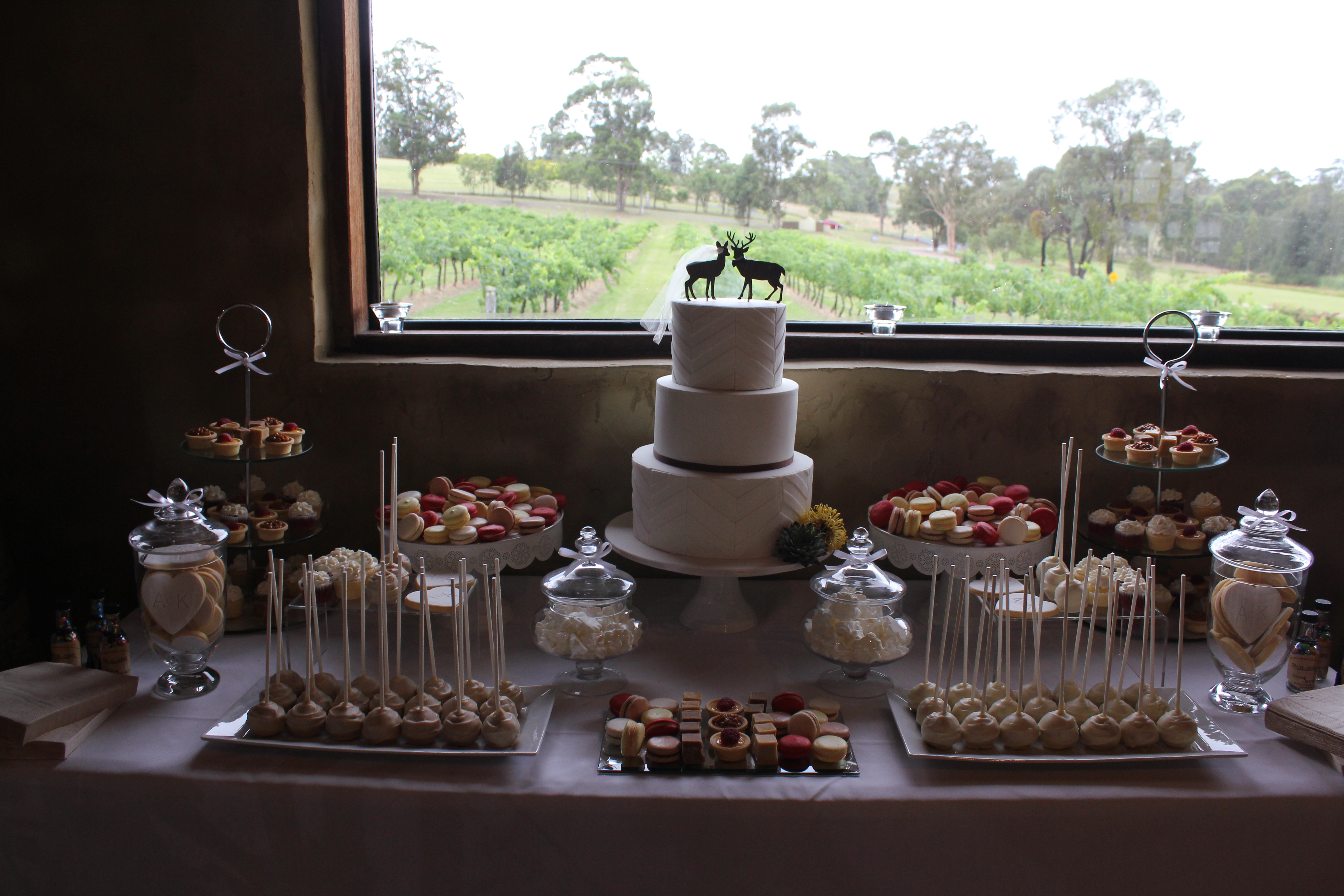 3 tier chevron panelled cake and rustic dessert table