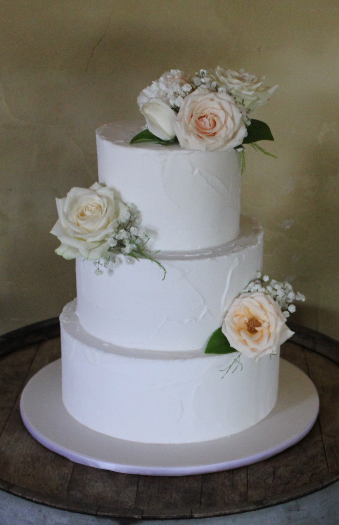 3 tier rustic royal iced with fresh flowers